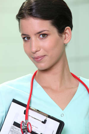 auscultation: A medical professional with a clipboard and stethoscope Stock Photo