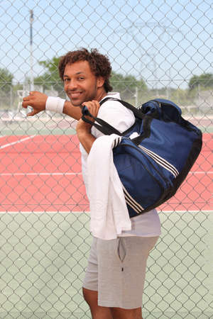 Tennis player with bag photo