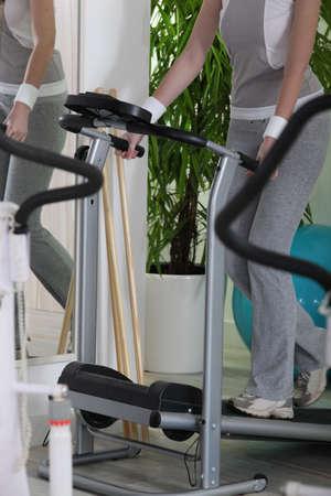 tilt: Woman on a treadmill