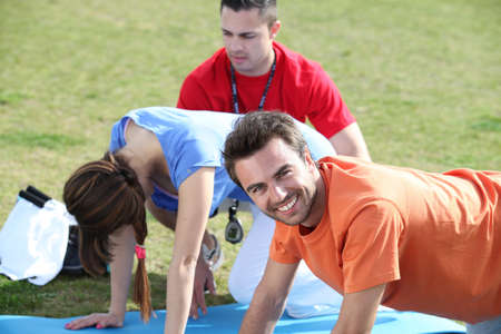 push ups: Young people doing press ups in the park