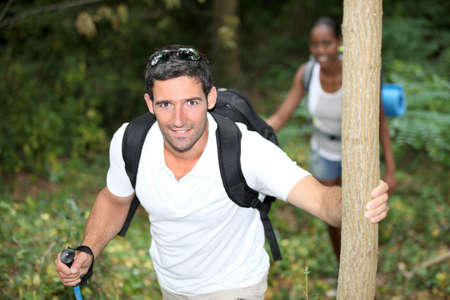 interracial love: happy couple on a mountain hike Stock Photo