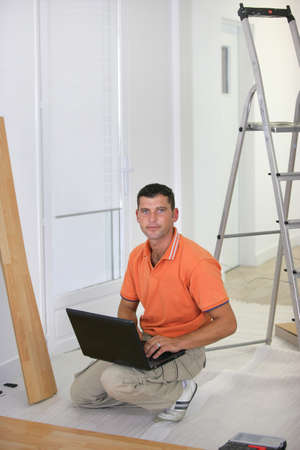 Floorlayer with a laptop computer Stock Photo - 11457072