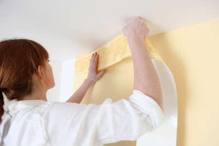 ornamentations: Woman putting up a wallpaper border