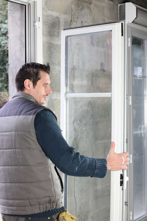 pvc: Worker installing French doors