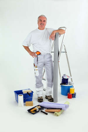 decoration work: Handyman stood with step-ladder Stock Photo