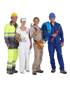 trabajadores: Cuatro trabajadores de diferentes oficios Foto de archivo