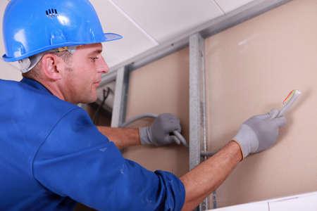 head collar: worker fixing something Stock Photo