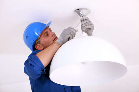 Installing the ceiling light. Stock Photo - 11457211