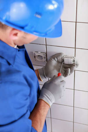 Electrician wiring a light switch Stock Photo - 11457067