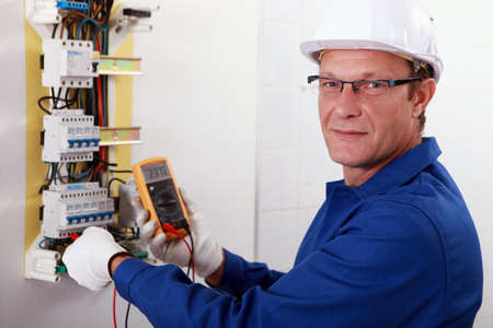 safety gloves: portrait of an electrician Stock Photo