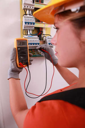 centralised: Female electrical engineer Stock Photo