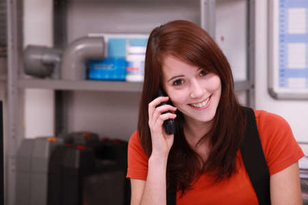 look pleased: Apprentice on the phone Stock Photo
