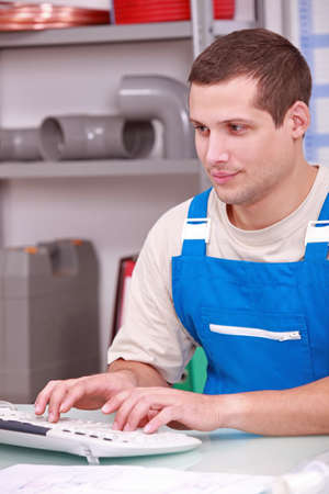 Plumber working in the office photo