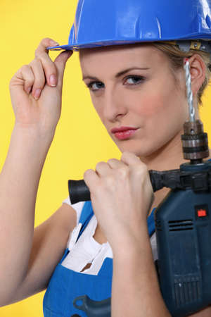 portrait of a woman with drill photo
