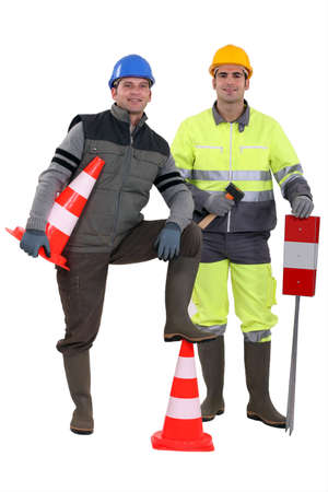 construction crew: two road workers posing together