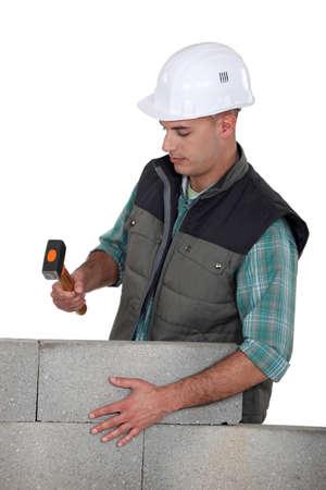 stonemasonry: Stonemason holding a mallet Stock Photo