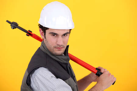 Man posing with bolt-cutters photo