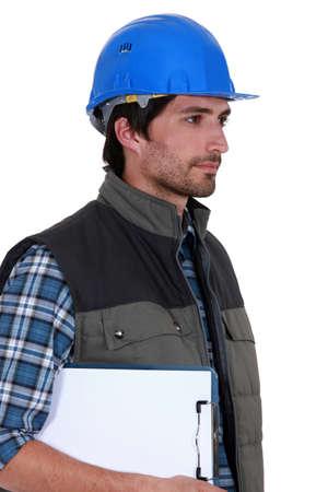 tasker: craftsman holding a notepad