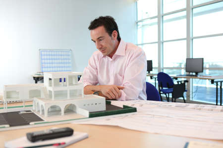architecture model: Architect with a model of a building Stock Photo