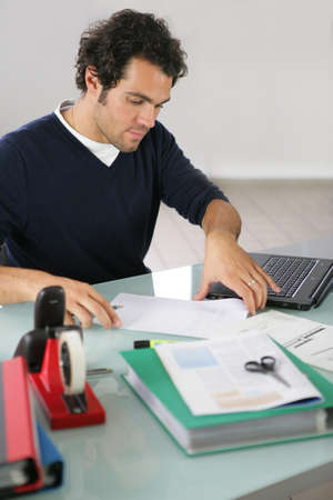 Man working at a desk photo