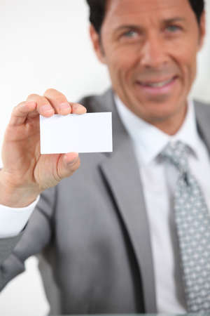 median age: executive giving business card Stock Photo