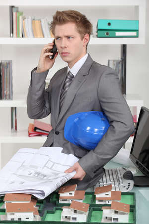 exasperate: An annoyed architect talking on the phone