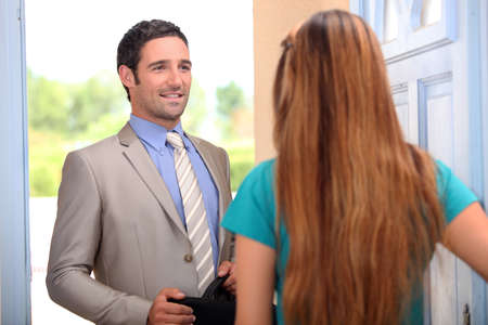 sales lady: portrait of a salesman with client