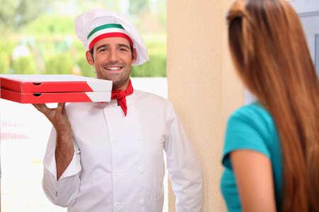 Italian chef bringing pizzas photo