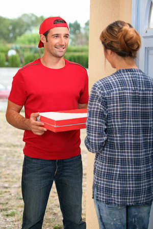 delivering: Pizza delivery man