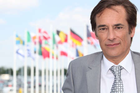 Businessman in front of flags photo