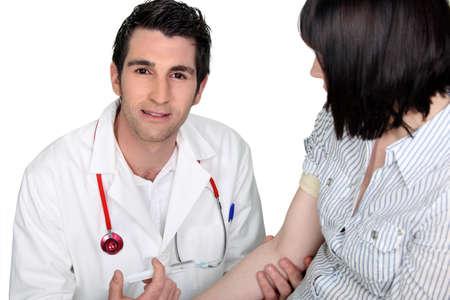 intravenous: Doctor injecting patient
