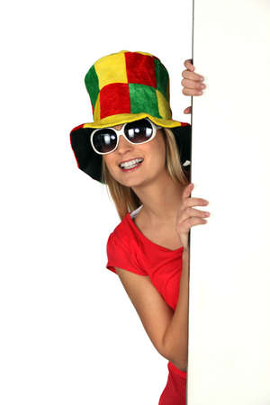 'hide out': Woman wearing a comical hat and sunglasses