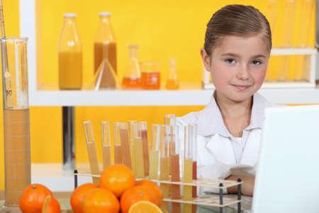 make belief: Girl analysing juice Stock Photo