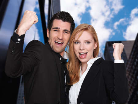businessteamwork: Excited business couple Stock Photo