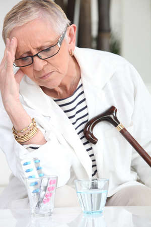 Elderly woman with a headache photo