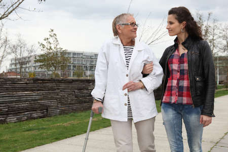 health concern: Woman strolling with an elderly lady