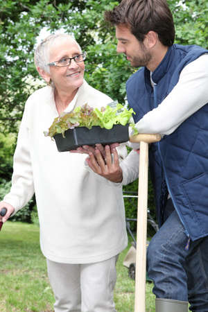 Mother and son gardening photo