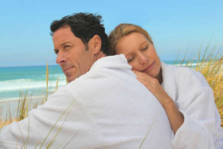 45 55 years: Couple relaxing on the beach Stock Photo
