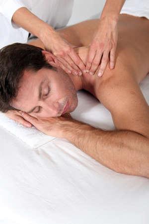 Man enjoying back massage photo