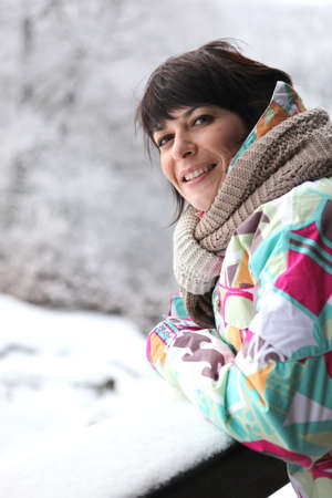 Woman wrapped up in the snow photo