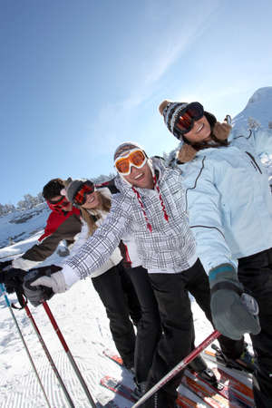 Two couples skiing together photo