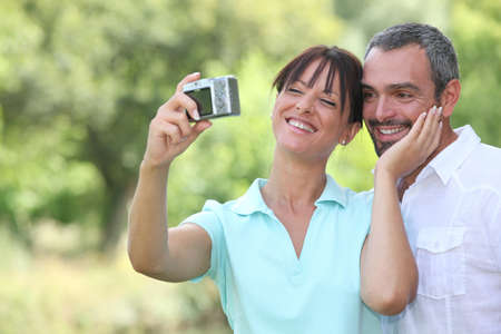 Couple in countryside taking photos photo