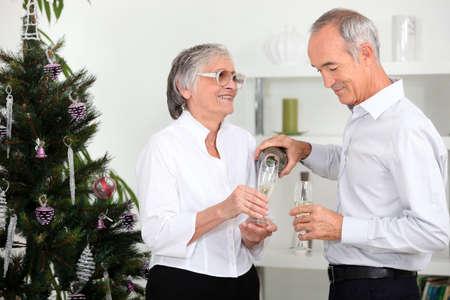 65 70 years: Couple celebrating Christmas together