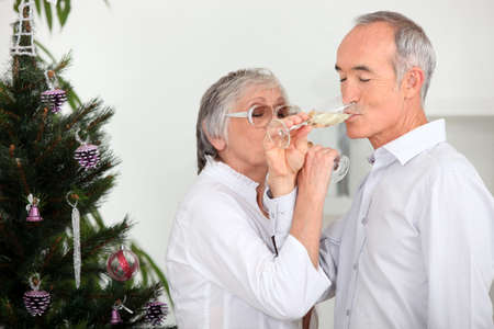 55 to 60: Couple drinking champagne