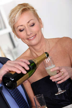 Man pouring champagne for wife Stock Photo - 11456811