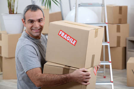 portrait of a man with cardoard boxes photo