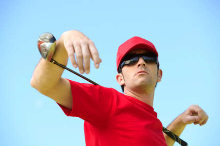 Golfer with club around his neck. photo