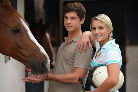 Young couple at a riding stable photo