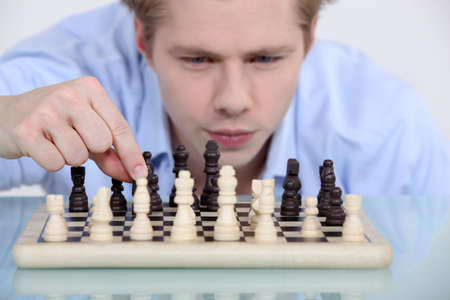 fair skinned: Man playing chess