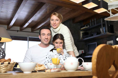 Young family having breakfast photo